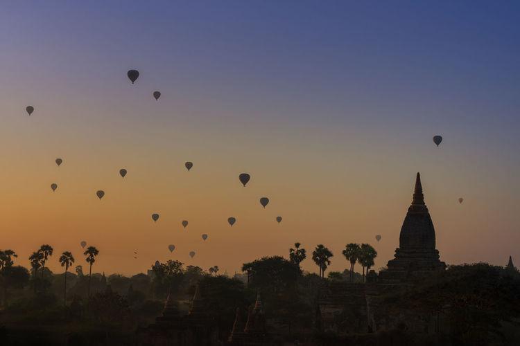 Sunrise many hot air balloon in bagan, myanmar. bagan is an ancient with many pagoda.