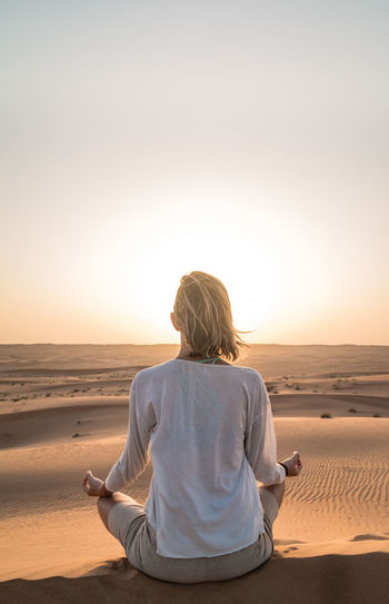 Calm Desert Meditate, Contemplate, Think, Consider, Ponder, Muse, Reflect, Deliberate Meditation Nature Oman One Person Peace Real People Relax Sunset Tranquil Scene Wahiba Sands Women Live For The Story