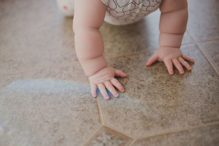 Close-up of child playing on floor at home
