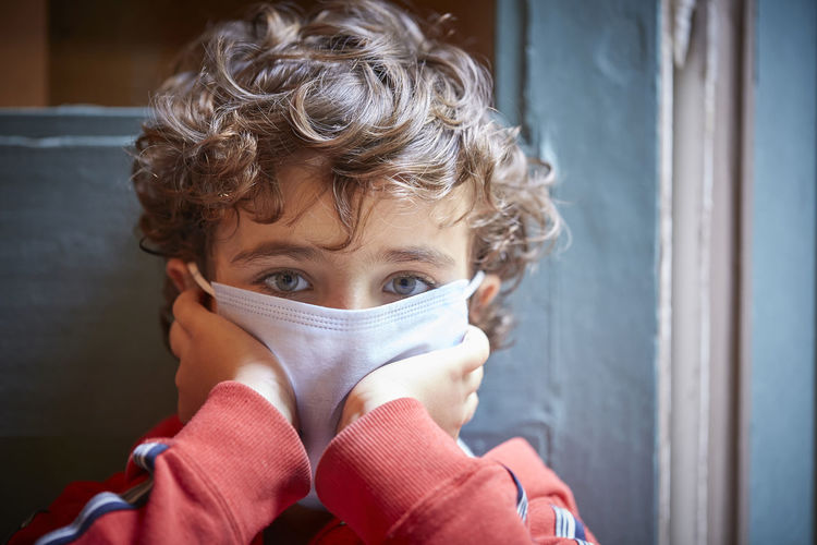 Close-up portrait of boy wearing mask