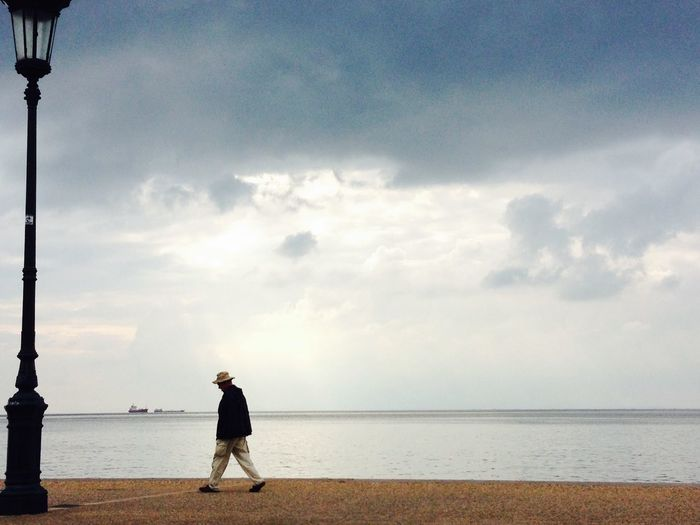Side-View Of Man Walking On Promenade