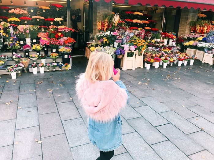 One Person Women Hair Blond Hair Standing Real People Street City Day Adult Childhood Girls Leisure Activity Child Multi Colored Lifestyles Outdoors Clothing Rear View Architecture