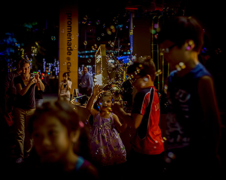 Kids In Christmas © Chit Min Maung http://www.cmmaung.me/ Arts Culture And Entertainment Best Christmas Lights C Cmmaung.me Kids Playing Soap Bubbles Street Streetphoto_color Streetphotography Paint The Town Yellow