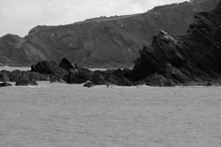 Black & White Coastline Beauty In Nature Black And White Black And White Friday Day Dramatic Landscape Horizon Over Water Landscape Monochrome Nature No People Outdoors Rocks Sea Sky Water