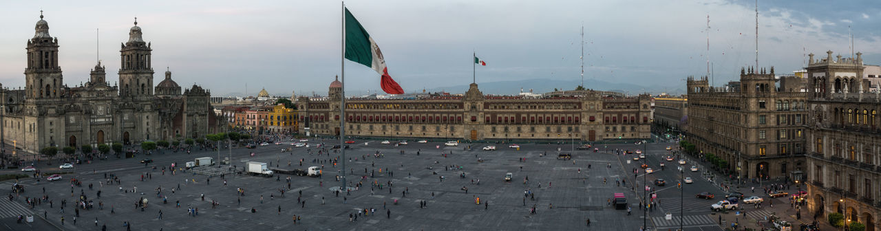 High angle panorama view on the Plaza de la constitucion Building City City Center Daytime Mexican Flag Mexico Mexico Cty Old City Panorama Peope Plaza De La Constitución Square Historical Building Tourist Destination Capital Cities  México City, Downtown District Travel Destinations CatedralMetropolitana Catedral Built Structure Building Exterior Architecture