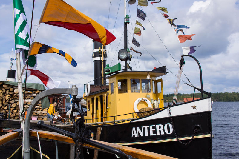 Mode Of Transportation Transportation Sky Flag Nautical Vessel Cloud - Sky Water Nature Day No People Patriotism Moored Focus On Foreground Text Outdoors Sea Travel Pole Sailboat National Icon