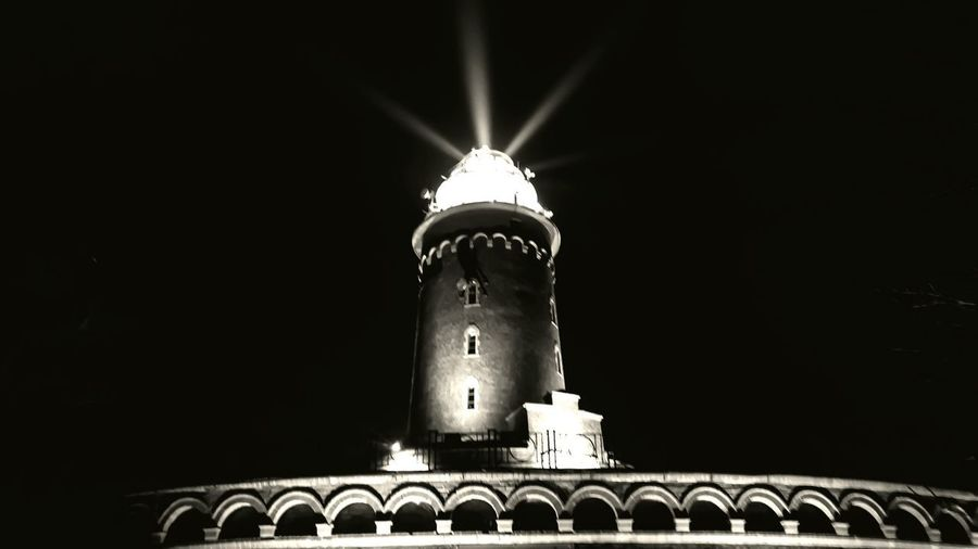 Low angle view of illuminated lamp against sky at night
