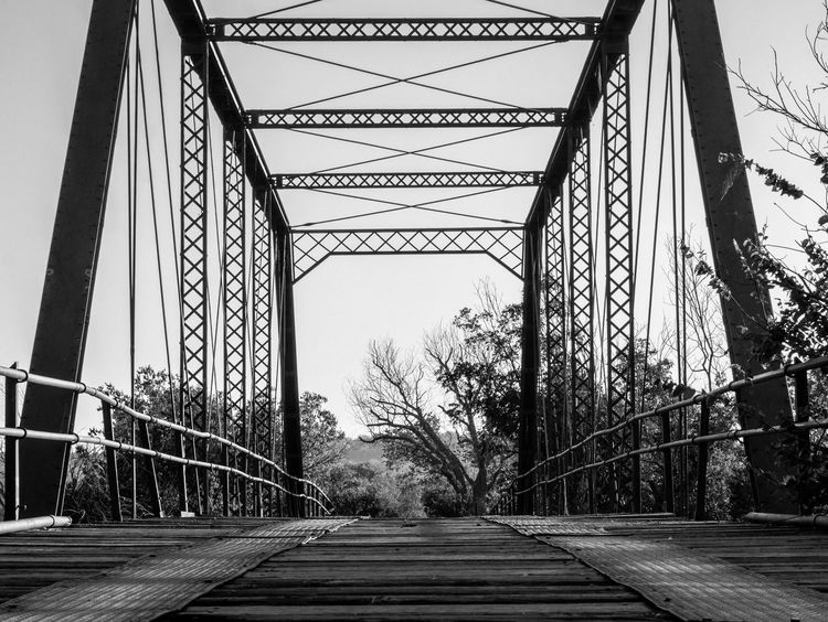 Bridge with a View b&w_8249 Architecture B & W  B & W Classic B&w B&W Collection B&w Photography Black & White Black And White Blackandwhite Bridge Bridge - Man Made Structure Built Structure Diminishing Perspective Engineering Low Angle View No People Non Urban Scene Not Used Anymore Outdoors Trestle Trestle Bridge