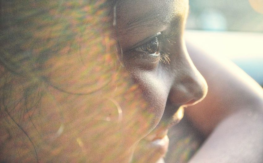 Close-up of teenage girl looking away