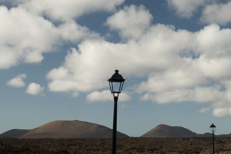street/land scape Nature Street Lamp The Great Outdoors - 2018 EyeEm Awards Black Rock Cloud - Sky Electric Lamp Lamppost Landscape Miscellaneous  Nature No People Non-urban Scene Outdoors Scenics - Nature Sky Street Street Light Tranquil Scene Tranquility Urban Landscape Volcanic Landscape Volcanic Rock Volcano