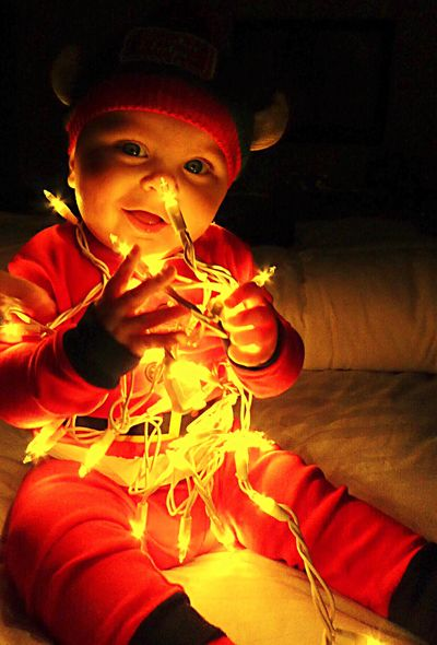 Getty Premium Collection Premium Childhood Indoors  One Person Celebration Cute Home Interior Boys Holiday - Event Illuminated Looking At Camera Portrait Christmas Lights Child Night Close-up Santa Pajamas Darkness And Light Little Boy Toddler  Wide Eyed Wide Eyes Sitting Illumination Mouth Open Selected For Premium