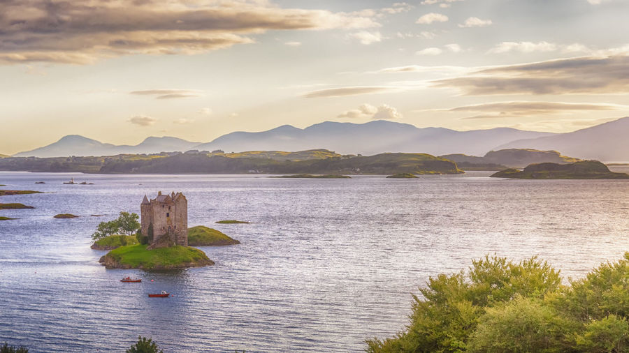 Castle Stalker, Loch Linnhe, Argyll and Bute, Scotland Castle Castle Stalker Cloud - Sky Day Ecosse Lake Landscape Loch  Loch Linnhe Mountain Nature No People Outdoors Scenic Scenics Scotland Sky Stalker Travel Travel Destinations Water