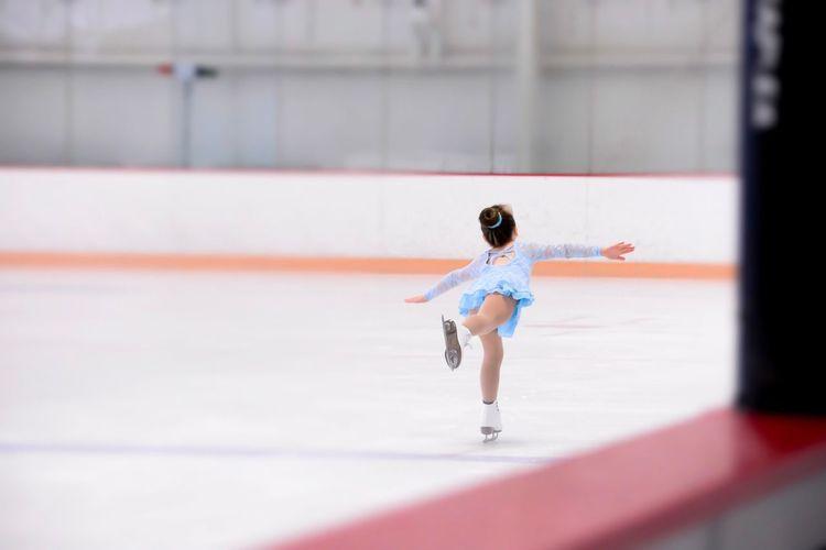 Full length of girl ice-skating