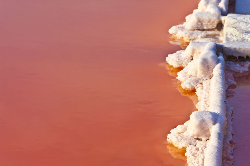Close-up of ice cream against orange sky