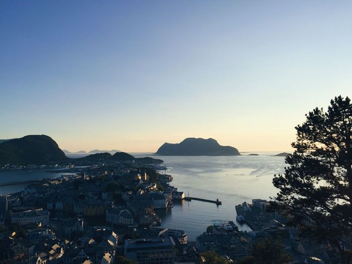 Before the night comes, aerial view of the city of Ålesund at sunset Evening Fjords Travel Destinations Ocean View Atlantic Ocean Ålesund, Norway Norway Norway🇳🇴 Perspective Roofs Harbour Harbor Blue Sky Point Of View Cityscape City Aerial View Idyllic Water Sky Scenics - Nature Nature Beauty In Nature Clear Sky Copy Space Sunset Tree Tranquil Scene Tranquility Land