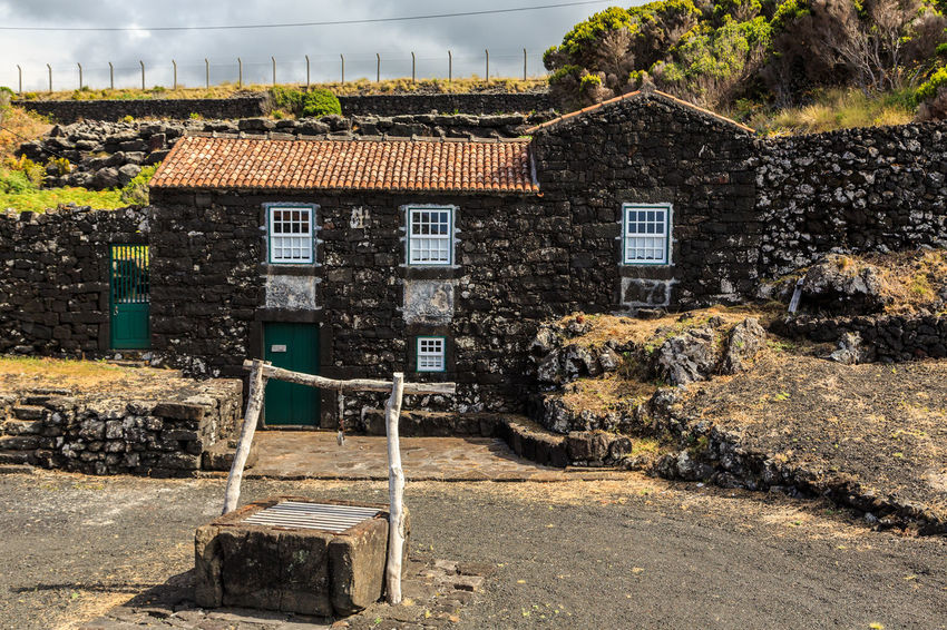 Azores Houses Pico Island Architecture Basaltic Rock Building Building Exterior Built Structure Day House Nature No People Outdoors Plant Residential District Road Sky Stone Wall Street Sunlight Tipical House Tree Wall Wall - Building Feature