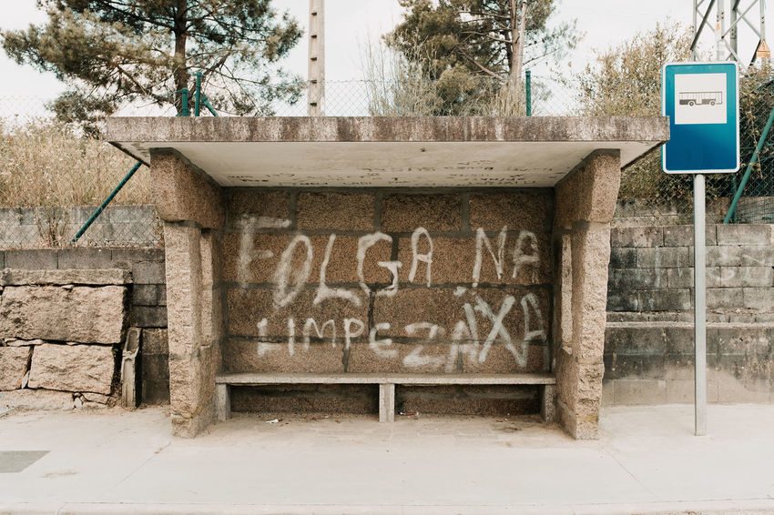 LOST IN GALICIA 🚌 Lostingalicia Threeweeksgalicia Bus Stop Day Sign No People Architecture Tree Information Outdoors Built Structure Building Exterior Abandoned Old Road Nature Guidance