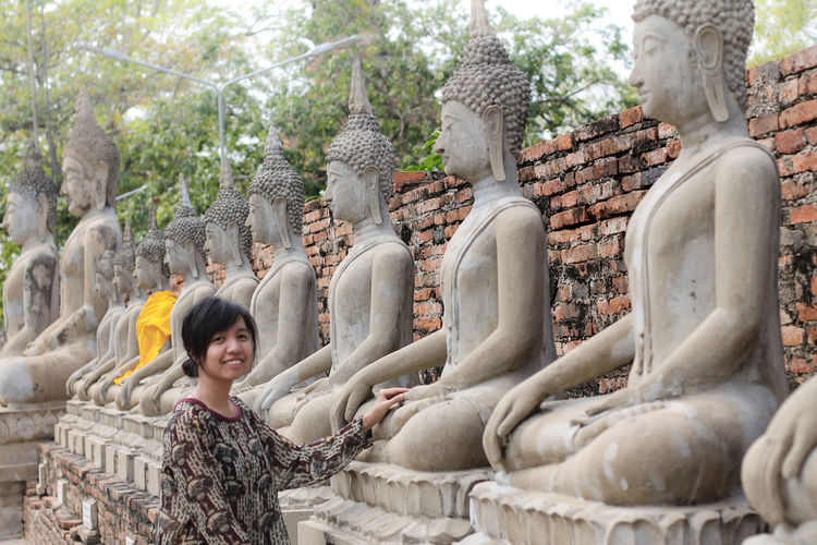 Thai Religion Tourism ASIA Travel Photography Casual Clothing Female Traveler Wat Yai Chai Mongkol Wat Yai Chai Mongkhon The Week on EyeEm Buddhism Famous Place Smiling Statue Portrait Place Of Worship Spirituality Religion Sculpture Looking At Camera Happiness Old Ruin Historic