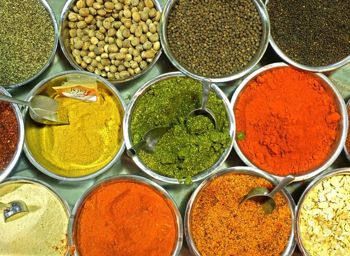 High angle view of various spices in bowls on table