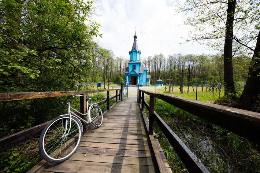 Cerkiew Prawosławna P.w. Ikony Matki Boskiej Wszystkich Strapionych Radość Church Church In The Wild Entrance Poland Polska Bicycle Bike Blue Church Pathway Poland 💗 Spring Springtime Wooden Path