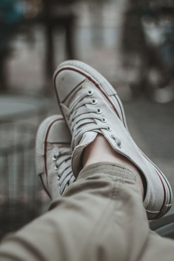 Body Part Canvas Shoe Casual Clothing Close-up Day Focus On Foreground Human Body Part Human Foot Human Leg Human Limb Jeans Legs Crossed At Ankle Low Section Men One Person Personal Perspective Real People Relaxation Selective Focus Shoe Unrecognizable Person