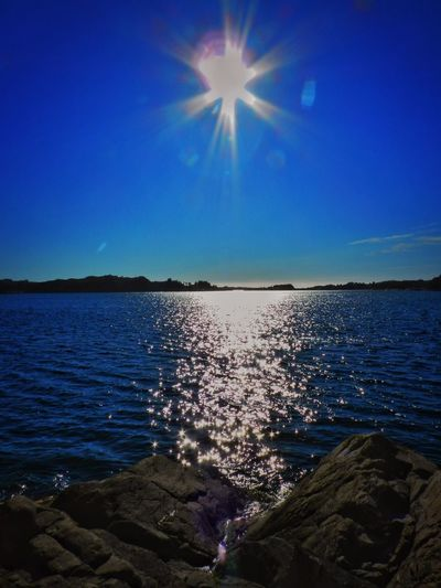 Norway Beach Beauty In Nature Blue Bright Clear Sky Idyllic Lake Lens Flare Nature No People Outdoors Reflection Scenics - Nature Sky Sun Sunlight Tranquil Scene Tranquility Water