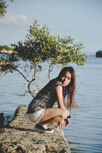 Gem One Person Looking At Camera Water Portrait Full Length Lifestyles Casual Clothing Plant Lake Outdoors Beautiful Woman Hairstyle Leisure Activity Young Adult Real People Tree Young Women Nature Hair Sky Day