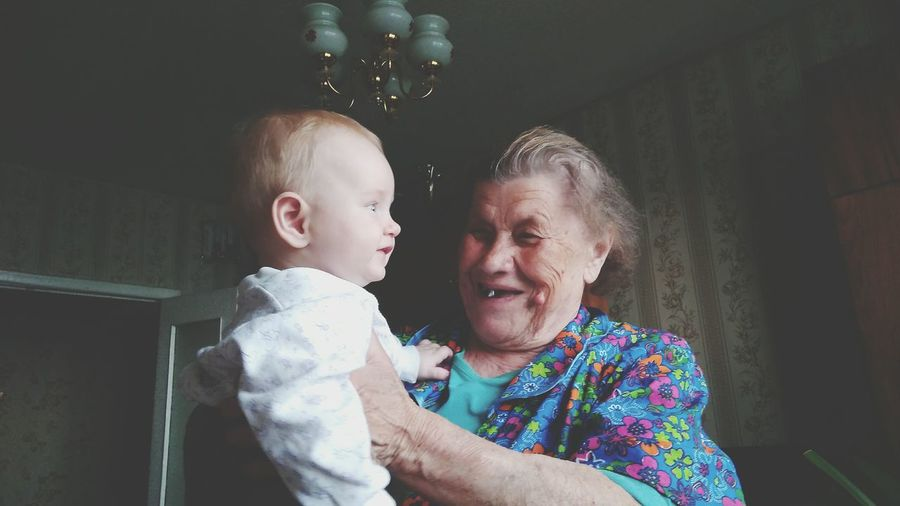 Low Angle View Of Happy Grandmother Looking At Grandson