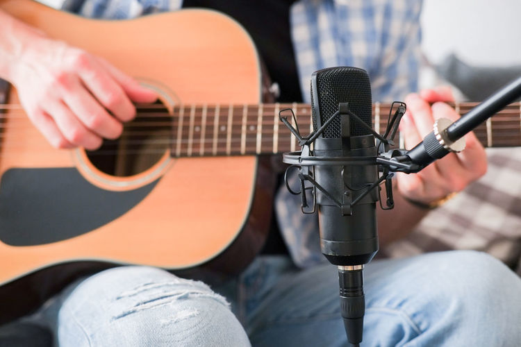 Musician recording acoustic guitar at home Music Recording Studio Recording Homerecording Home Studio Music Recording Musical Equipment Microphone Musician Guitar Playing Playing Guitar Guitarist Artist Condenser Microph Microphone Stan Fingerpicking Acoustic Guitar