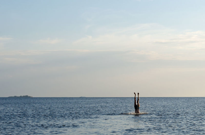 Day Dive Fun Horizon Over Water Jump Leisure Activity Lifestyles Men One Person Outdoors People Real People Scenics Sea Sea And Sky Sky Water Waterfront