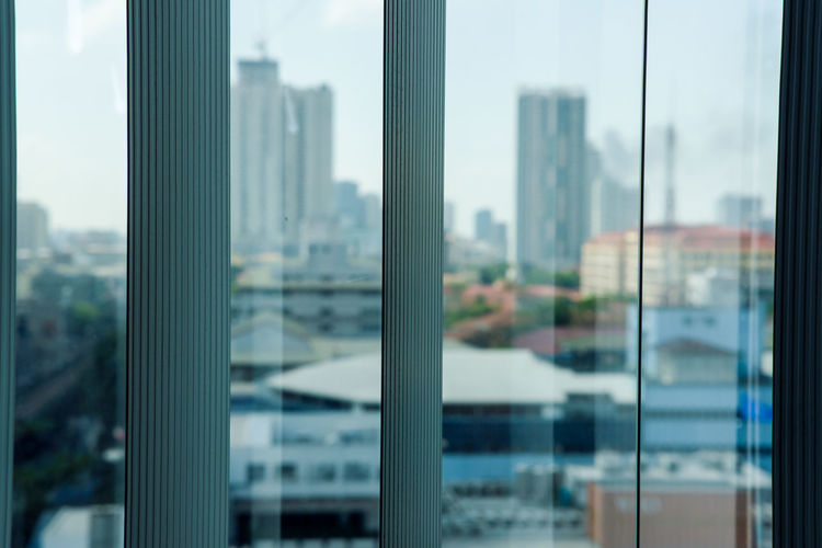 Close-up of cityscape seen through glass window