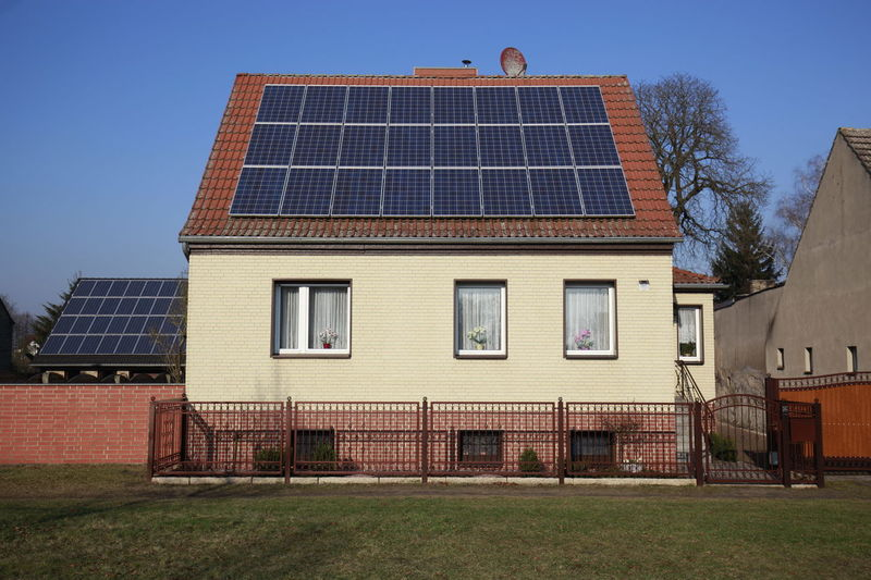 Alternative Energy Architecture Building Exterior Built Structure Day Environmental Conservation Fuel And Power Generation House No People Outdoors Renewable Energy Residential Building Roof Sky Solar Energy Solar Equipment Solar Panel Window