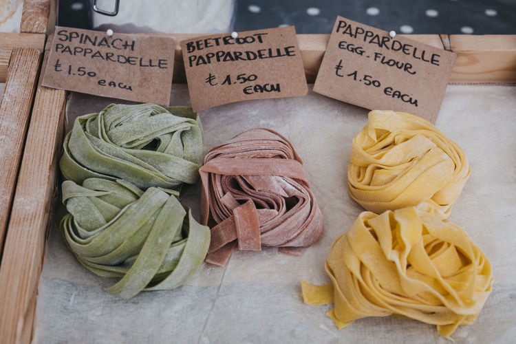 Artisan pasta on sale at an outdoor pop up street market. Wellbeing Price Fresh Pasta Fresh Still Life High Angle View Egg Flour Pasta Beetroot Pasta Parpadelle Spinach Pasta Healthy Eating For Sale Choice Close-up Italian Food Pasta Market Stall Retail  Freshness Food No People Food And Drink Food Market Market London