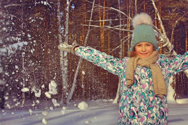 walk in the woods Walk In The Woods Childhood One Person Child Girls Clothing Winter Smiling Cold Temperature Happiness Innocence Nature Knit Hat Arms Raised Snowing Limb Outdoors Portrait