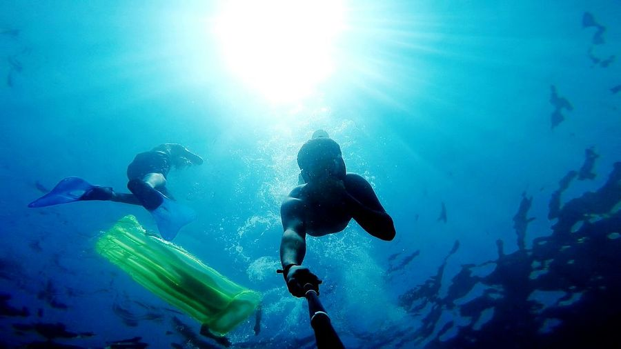 People free diving in sea