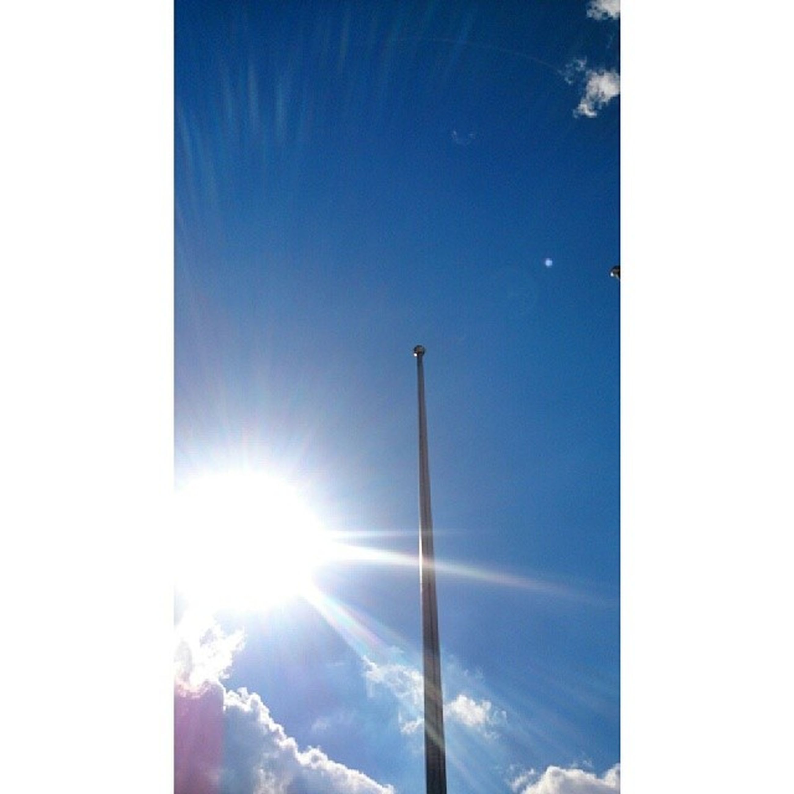 sun, sunbeam, blue, sunlight, lens flare, low angle view, sky, bright, sunny, beauty in nature, nature, transfer print, clear sky, day, auto post production filter, tranquility, vapor trail, no people, scenics, outdoors