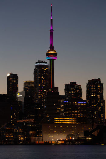 Illuminated buildings in city at night sunset cn tower