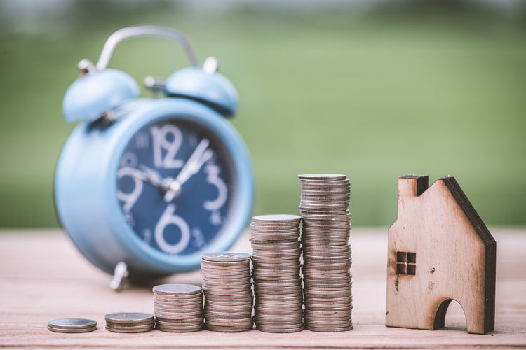 Finance Coin Wealth Stack Focus On Foreground Metal Still Life Close-up Savings Business No People Selective Focus Number Currency Time Investment Silver Colored Clock Table Finance And Economy Economy Clock Face