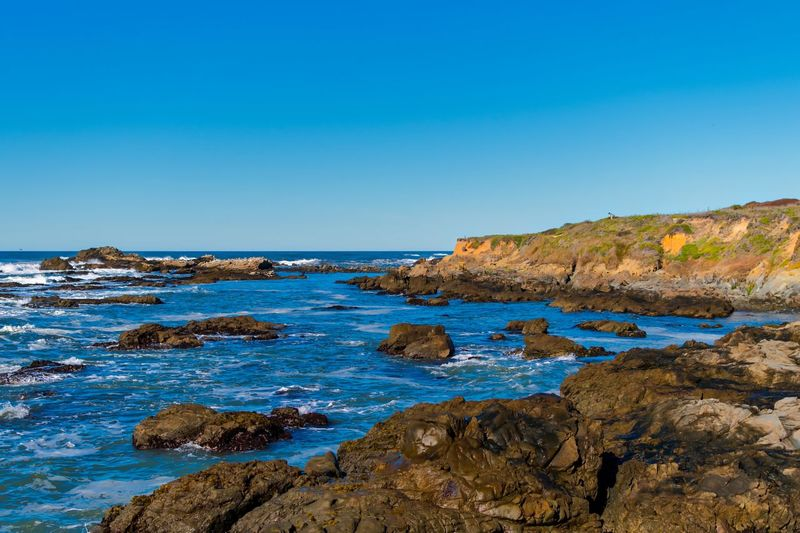 Beauty In Nature Blue Clear Sky Day Horizon Over Water Landscape Nature No People Outdoors Rock - Object Rock Formation Rocky Coastline Scenics Sea Sky Tranquil Scene Travel Destinations Water