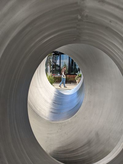 Rear view of boy in tunnel at playground