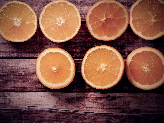 Citrus Fruit Food And Drink Fruit Healthy Eating Wellbeing SLICE Freshness Food Orange - Fruit Orange Color Orange Cross Section Wood - Material Group Of Objects No People Indoors  Table Close-up Still Life Medium Group Of Objects Sour Taste