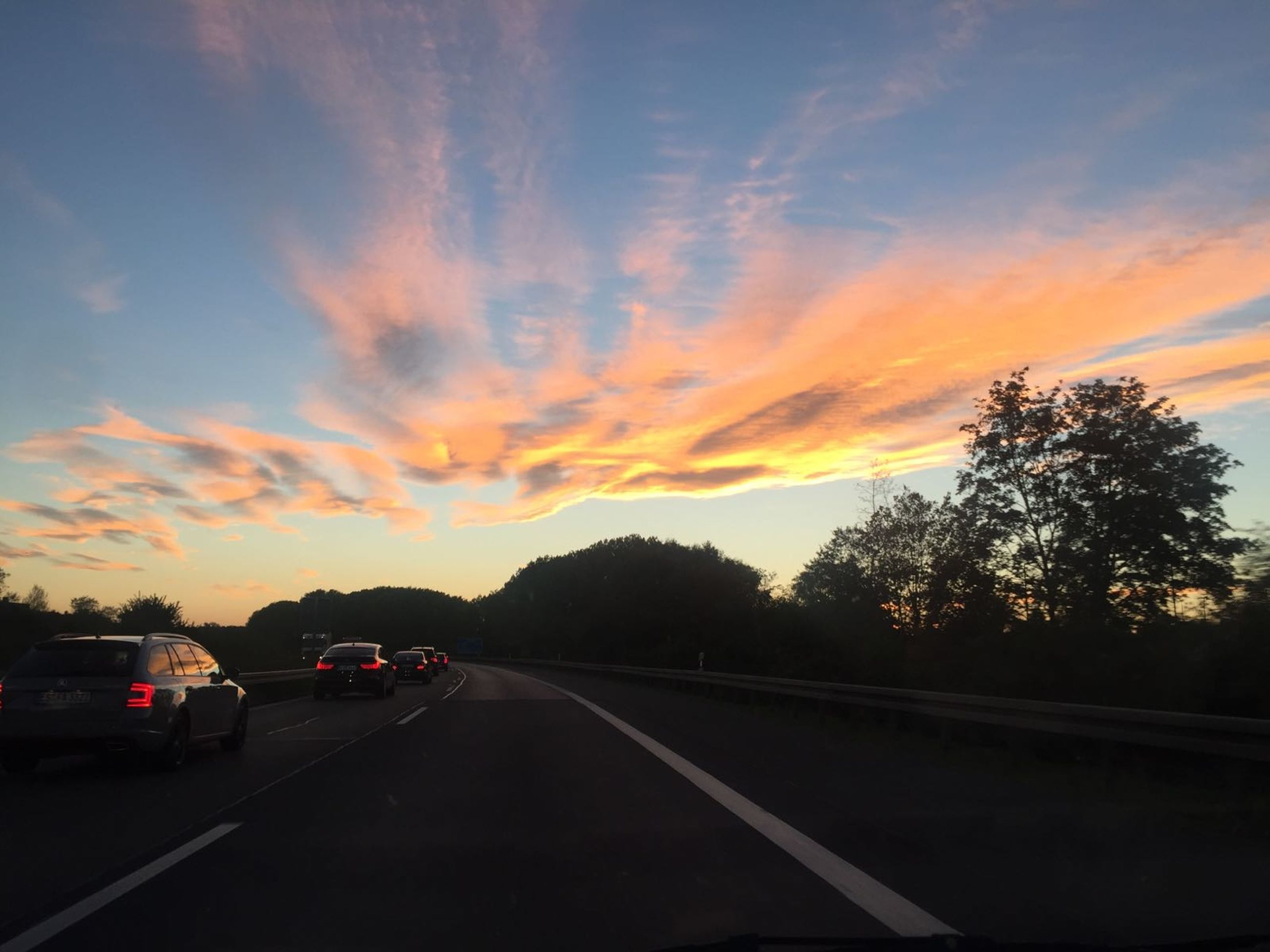 road, transportation, car, sunset, tree, mode of transport, highway, sky, travel, land vehicle, the way forward, nature, cloud - sky, no people, outdoors, scenics, day