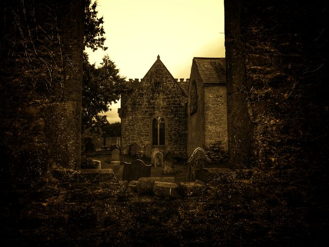 Hello World Taking Photos Check This Out From My Point Of View Ireland🍀 Outdoors Ancient Graveyard Gravestones And Monuments Light And Shadow Creepy Atmoshpere The Places I've Been Ancient History Sepia_collection Tea Lane Graveyard St Mochuas Eyeem2017 Built Structure Architecture Building Exterior Sky Croses Graveyard Collection Atmospheric Mood Beauty In Nature Old Church