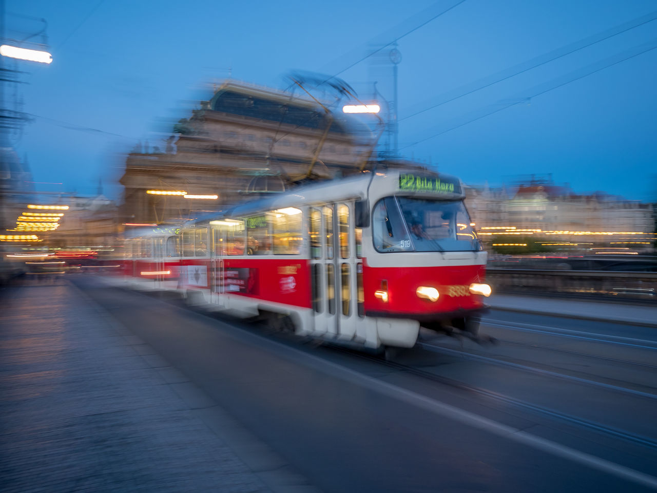 transportation, blurred motion, motion, illuminated, mode of transport, cable, public transportation, land vehicle, night, outdoors, no people, building exterior, electricity pylon, architecture, sky