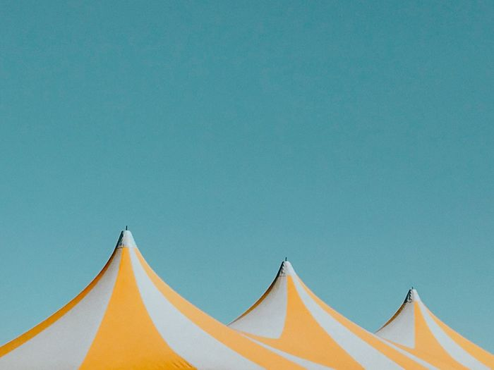 Low angle view of tent against clear blue sky