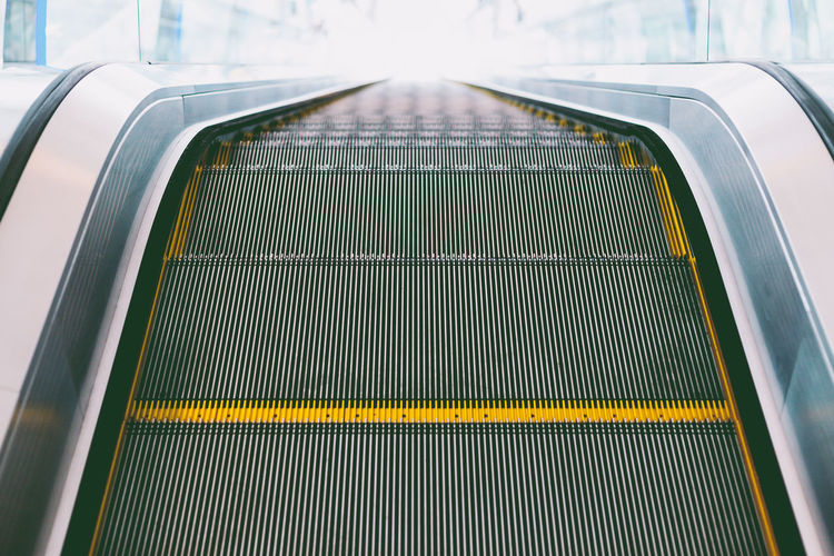 Escalator Metal Transportation Railing No People High Angle View The Way Forward Direction Mode Of Transportation Staircase Architecture Day Technology Convenience Indoors  on the move Pattern Empty Motion Moving Walkway  Silver Colored Steel