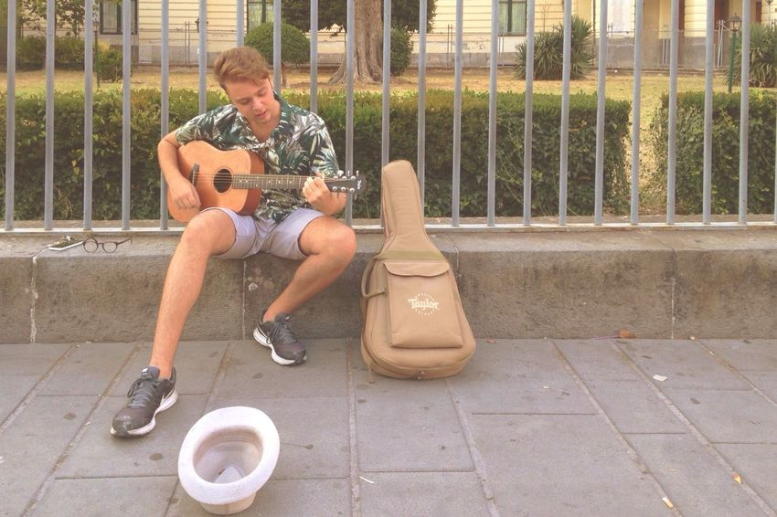 Street music Outdoors Full Length Sitting One Man Only Casual Clothing Only Men Front View One Person Day Adult People Arts Culture And Entertainment Music Adults Only Men Musician Young Adult Wireless Technology Guitar City Done That. Been There. Second Acts EyeEmNewHere
