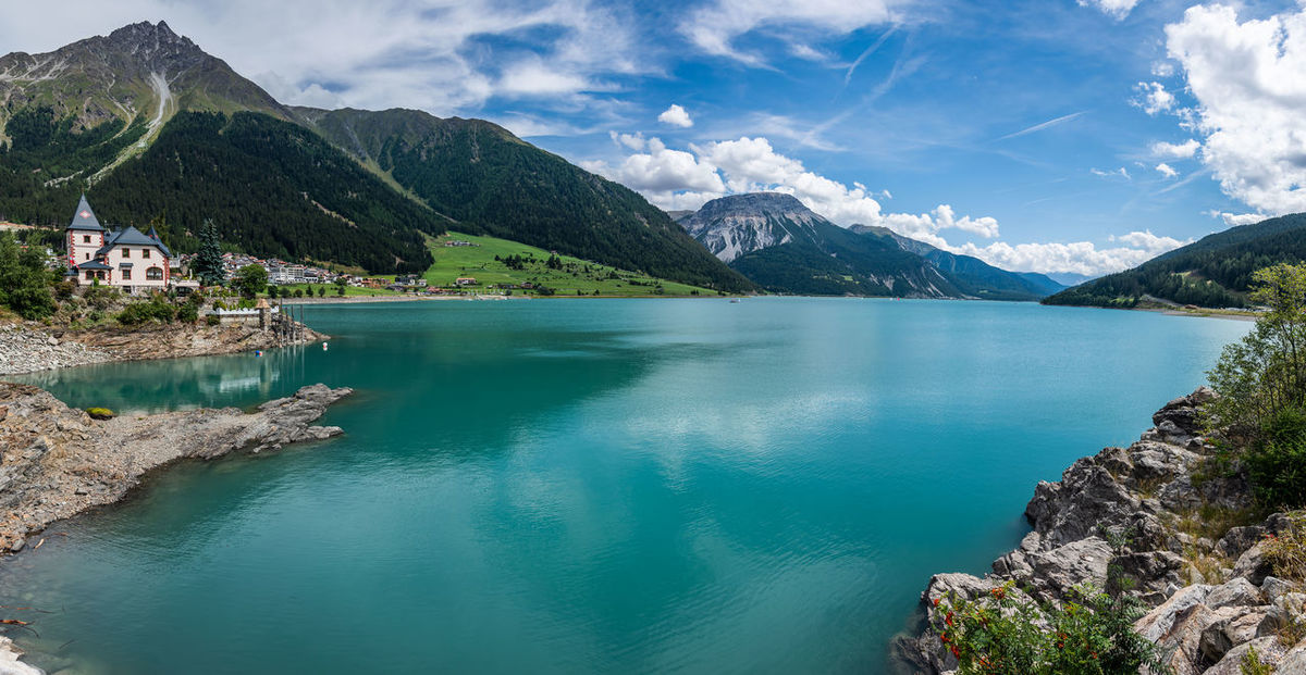 Alto Adige Reindeer Reschensee Alps Beauty In Nature Day Italy Lago Di Resia (Reschensee) Lake Mountain Nature Outdoors Reschen Scenics - Nature Shore Sky South Tyrol Vinschgau Water