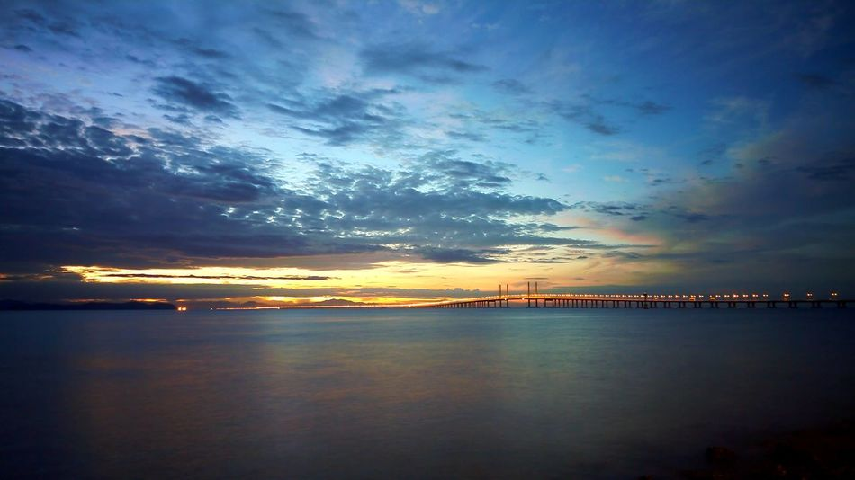 Penang Bridge Penang Second Bridge Reflection Sunset Sky Sea Beauty In Nature Water Cloud - Sky Outdoors Tranquility City Scenics No People Nature Beach Skyscraper Cityscape Day 3XSPUnity IMography PhonePhotography Samsung Galaxy Note 5 Bridge - Man Made Structure Penang Malaysia Penang Malaysia