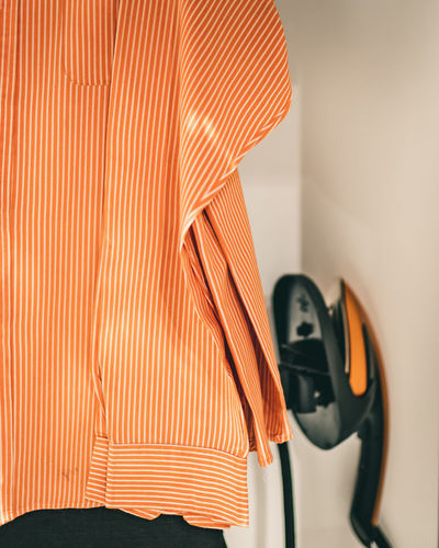 Close-up of clothes on wall at home